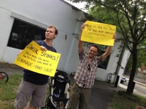 Alastair (left) and our friend Mark Erelli advertise the cause.