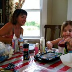 Clio paints with Gail from Our Space, which does art projects with kids with cancer. Click to visit their website.
