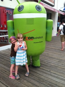 The girls want their pictures taken with any and all costumed characters. Even weird corporate spokesrobots.