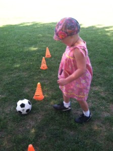 Clio tests out her new cleats for soccer this fall. (Yes. With a sundress.)